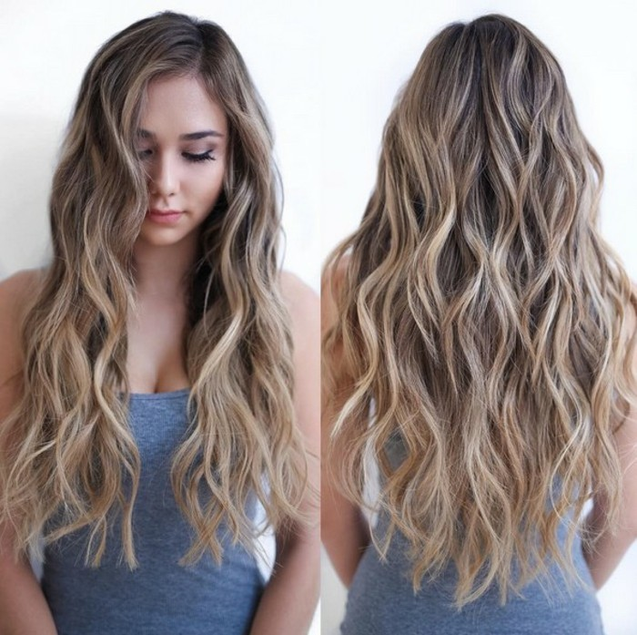 sand blonde balayage, on waist-length brunette hair, with beach curls, worn by a slim young woman