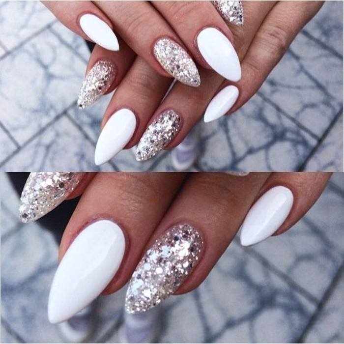 silver glitter flakes, and white nail polish, on pointy nails, worn by two hands, seen in a close up, and an extreme close up