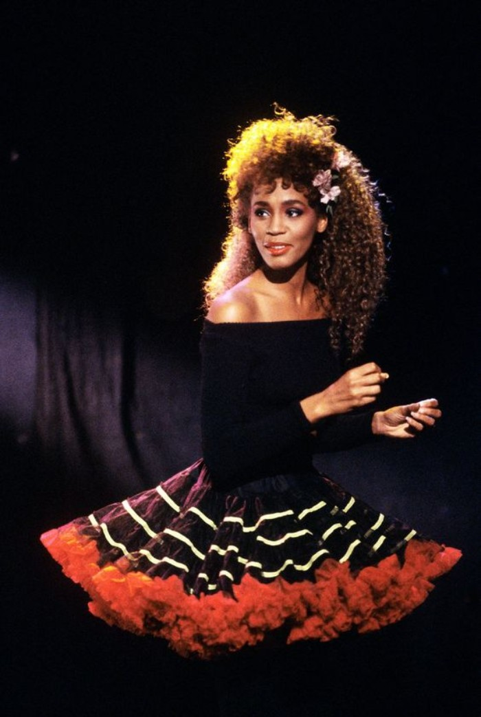 flared tulle skirt, in black and white, with red trim, worn with a black, off-the-shoulder jumper, by a young whitney houston, with curly long hair, 80's dress up ideas