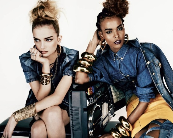 two young women, sitting next to each other, dressed in denim outfits, heavily inspired by the 1980s