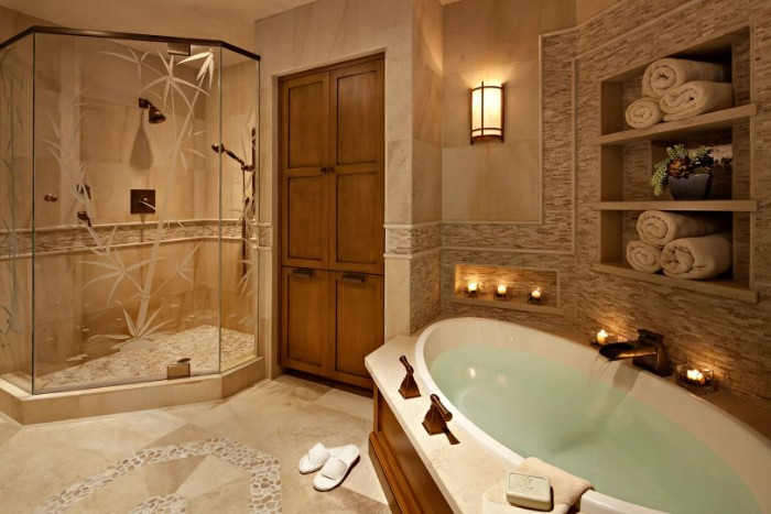 clear glass shower cabin, decorated with engravings of bamboo shoots, inside a bathroom, with a large oval bath, tiled floor and walls