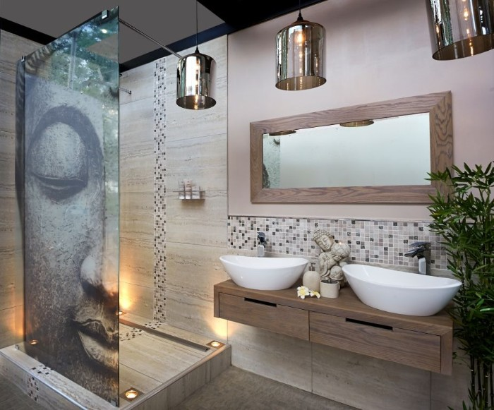 image showing the face of buddha, decorating a shower cabin, inside a room with a large mirror, master bathroom ideas, two sinks and three lamps