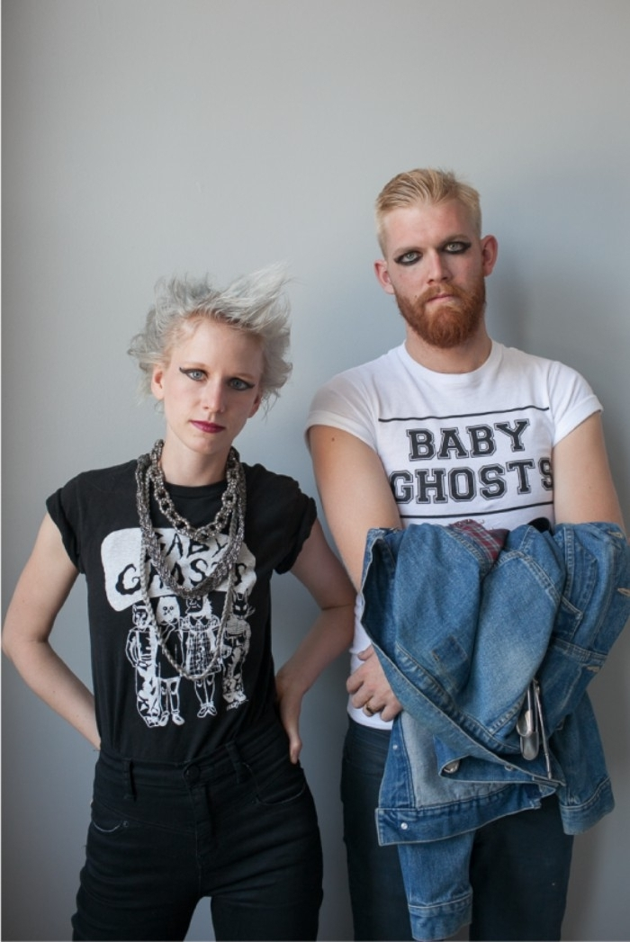 platinum blonde young woman, with spiky and messy hair, dressed in black and wearing bold eye makeup, next to a man with similar makeup, couples halloween costume ideas, punk rockers