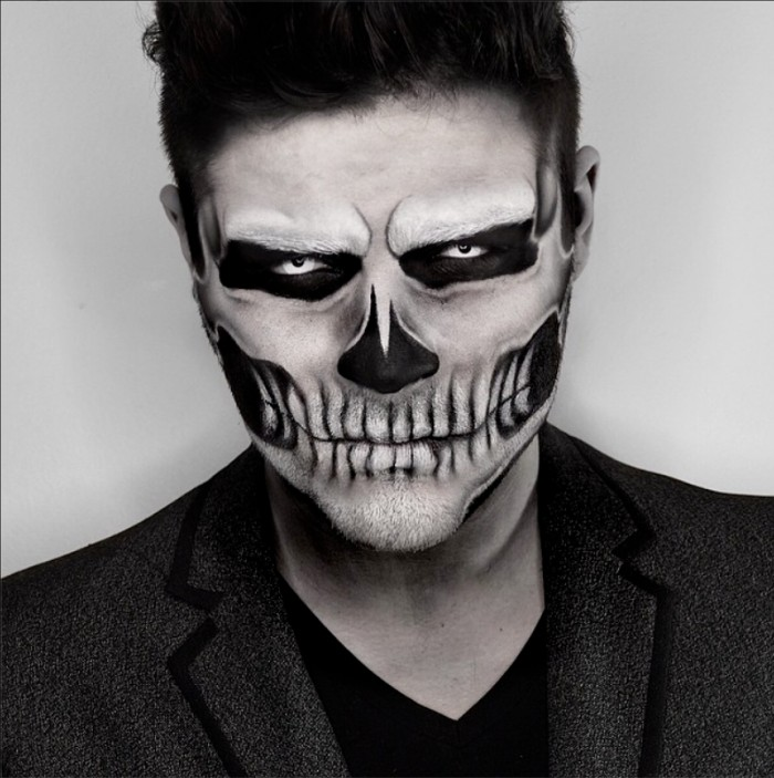 smartly dressed man, wearing an angry skull face paint, done with red and black colors, halloween costumes idea