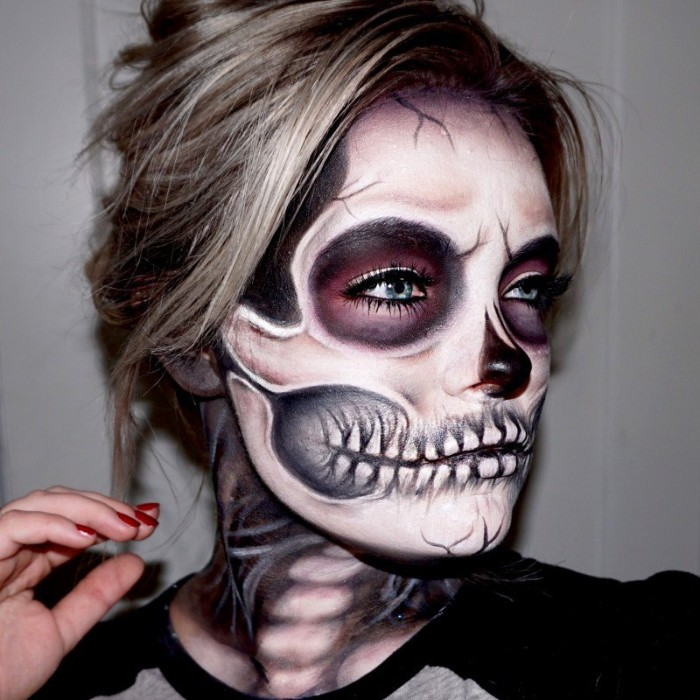 ash blonde young woman, wearing realistic skull makeup, halloween face paint ideas for adults, hair tied in a messy bun