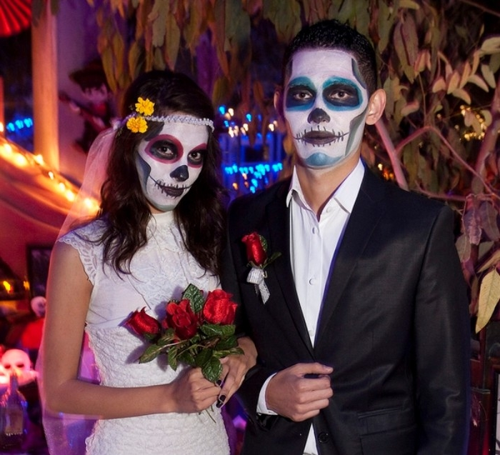 dia de los muertos halloween costumes, bride and groom with painted faces, made to look like skulls