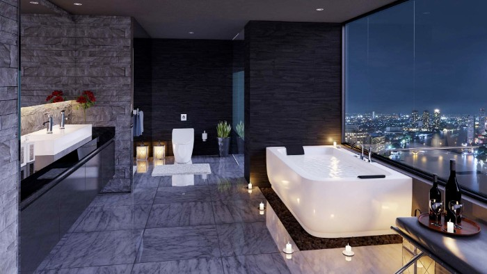 night view of a city, seen from the windows of a dark room, containing a large white bathtub, bathroom remodel pictures, several lit candles