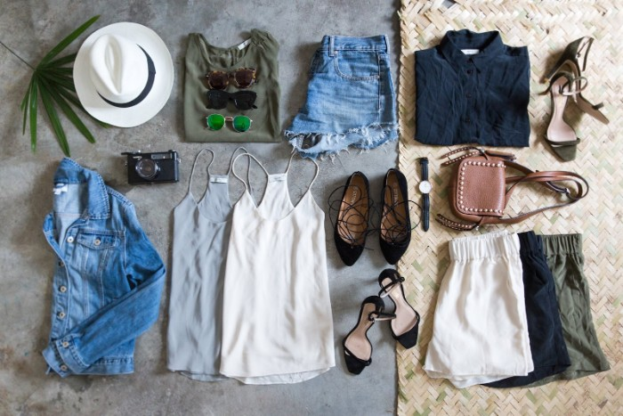 summer wardrobe essentials, two tank tops, three pairs of shorts, blue denim cutoffs, t-shirt and blouse, hat and other accessories
