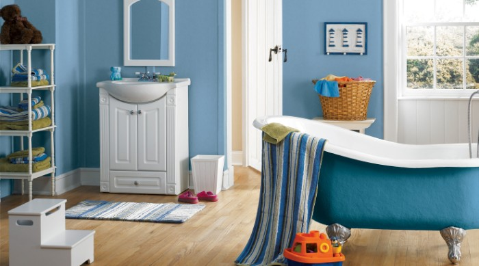 bathroom paint colors, pale blue walls, in a room with light beige laminate floor, containing an antique, blue and white clawfoot tub