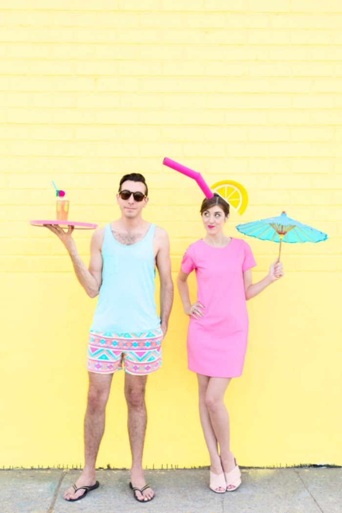 waiter and cocktail, quick halloween costumes, woman in a pastel pink mini dress, with a faux straw and lemon wedge, holding a large cocktail umbrella, man in shorts and tank top, holding a tray with a drink