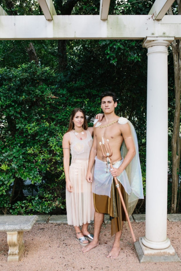 athletic young man and woman, dressed like a mermaid and a merman, couples halloween costume ideas, sheer pale peach midi dress, with top and skirt underneath, cape and trident