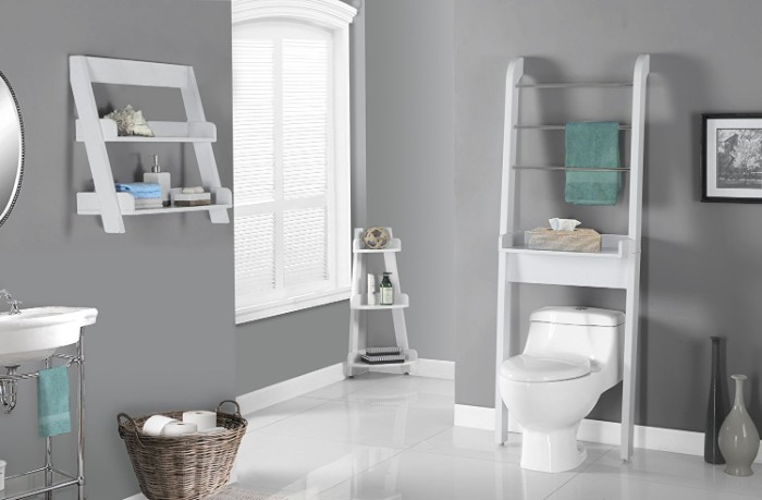 towel rack in white, placed over a white toilet, in a bathroom with medium grey walls, and a shiny white floor, window and shelves with toiletries