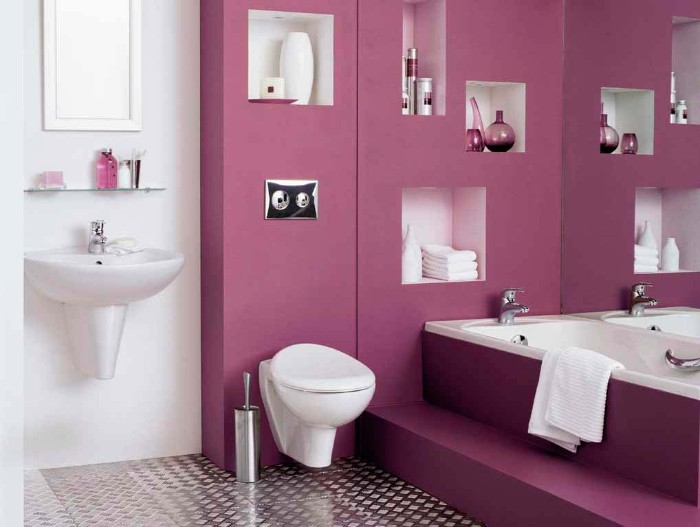 metallic silver floor, in a white room, with a dark pink, bathroom accent wall, a sink and a mirror, a toilet and a tub