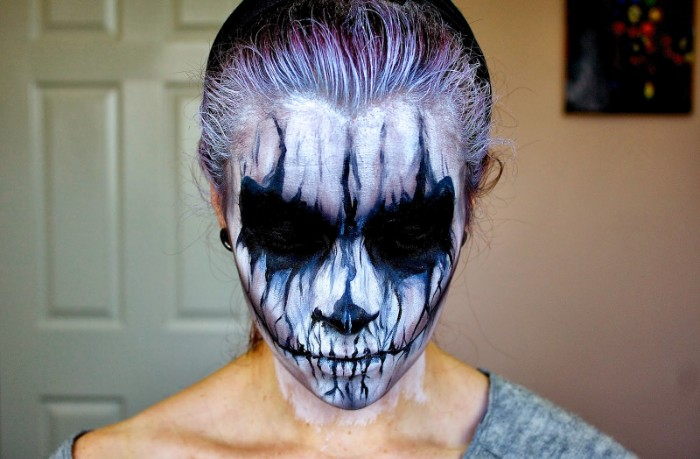ghost or demon makeup, halloween face paint ideas for adults, face covered in white, with black smudges