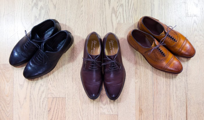 smart shoes for men, brogues in black, dark and light brown, capsule wardrobe men, on a laminate floor