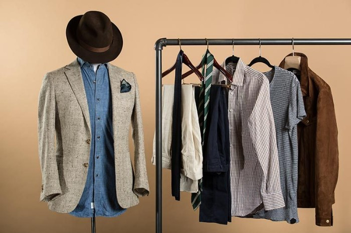 blazer in pale beige, on a dummy wearing a denim shirt, and a dark brown hat, wardrobe essentials for men, metal rack with more clothes nearby