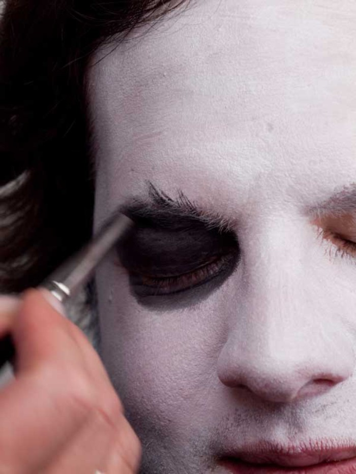 bushy eyebrows and eyelids covered in black paint, clown face paint, inspired by the joker from batman