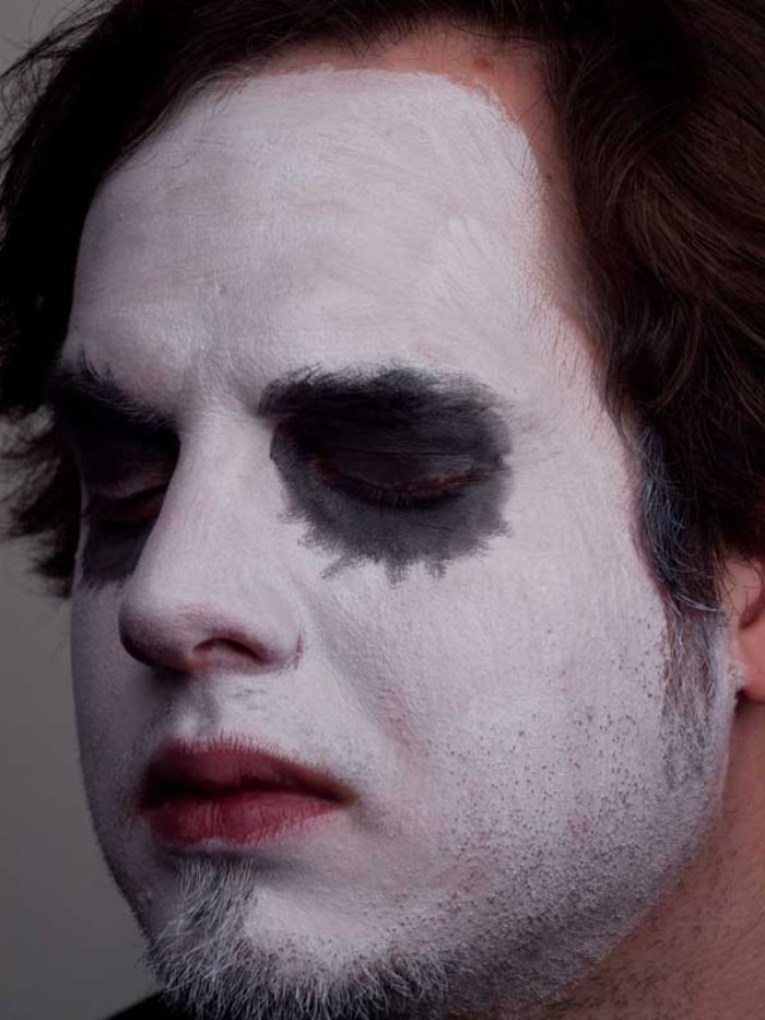 closed eyes covered in black makeup, on a face painted in white, clown face paint, the joker from batman, diy halloween costume