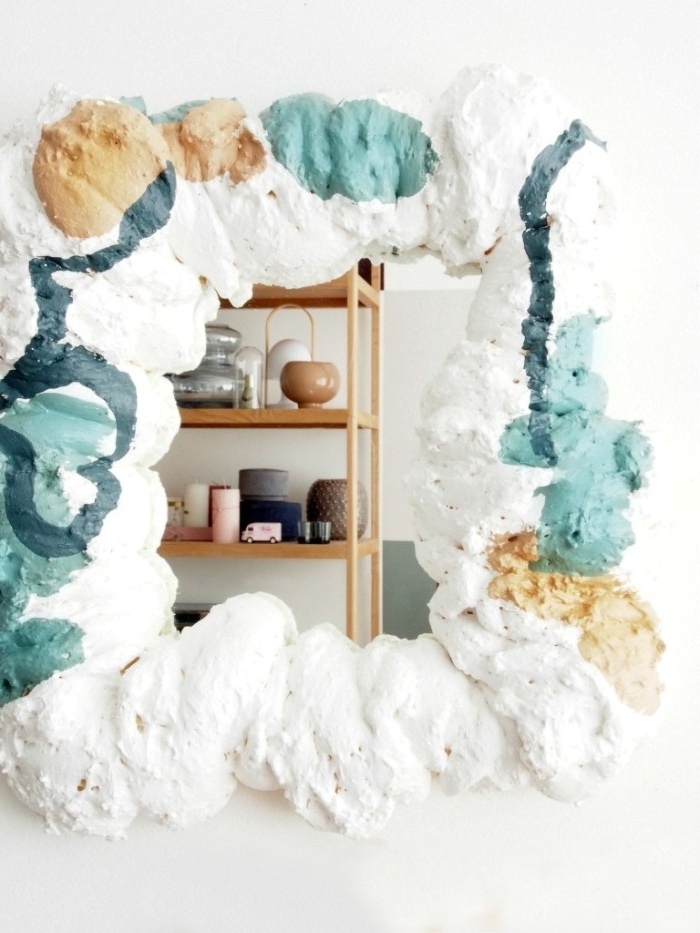 multicolored frame made from expanding foam, containing a small mirror, diys to do at home, easy and effective