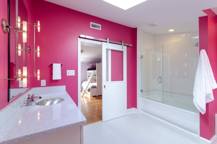 glass shower cabin, in a room with fuchsia pink and white walls, best paint for bathrooms, pale grey countertop with an inbuilt sink