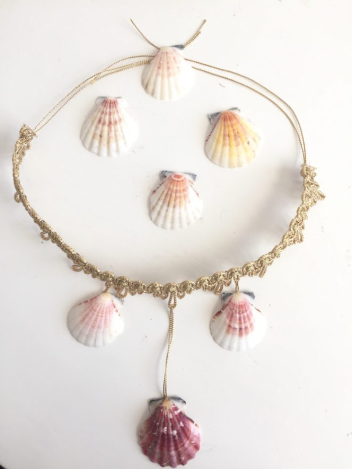 necklace made with gold grochet lace, string in the same color, and several seashells, couple costume ideas, diy mermaid outfit