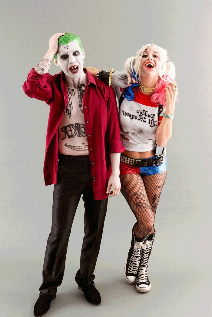 laughing young woman, dressed like harley quinn, leaning on a man dressed like the joker, couple costume ideas, characters from suicide squad