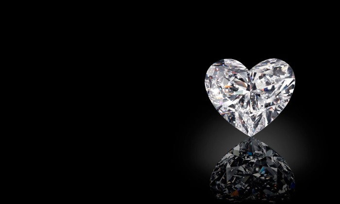 white diamond cut in a heart shape, standing on a black reflective surface, digitally created image