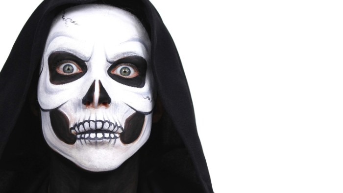 person wearing a black hood, with a realistic skull face paint, done with white and black paint