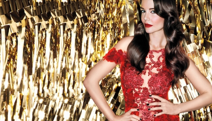 shiny dark brunette hair, long and wavy, on a slim woman, dressed in a semi-sheer red lace dress, holiday makeup 2017, red lipstick and black eyeliner