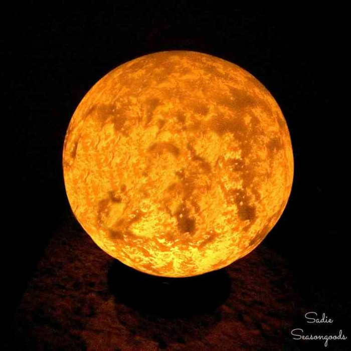 finished glowing moon lamp, halloween witch decorations, round white lamp, painted with beige on the inside, to resemble the moon