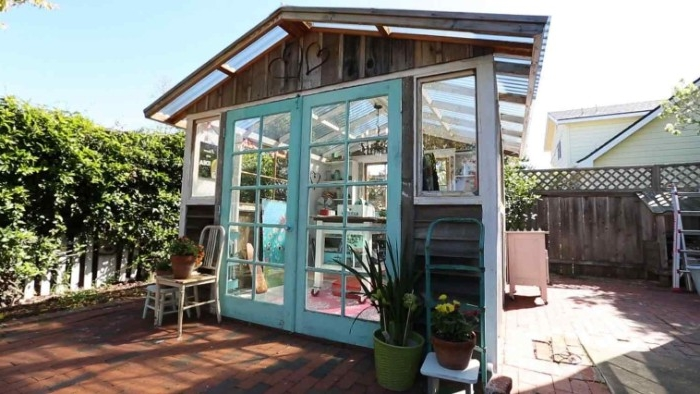 greenhouse style shed, with glass panels on the roof, lots of windows, and two glass doors, garden shed ideas, brown and white and pale blue color scheme