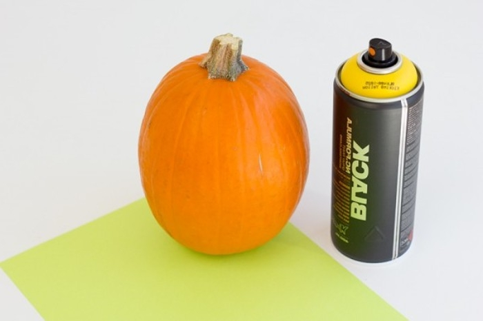can of yellow spray paint, medium sized oval pumpkin, a sheet of light green paper or card, diy bedroom décor, the materials needed