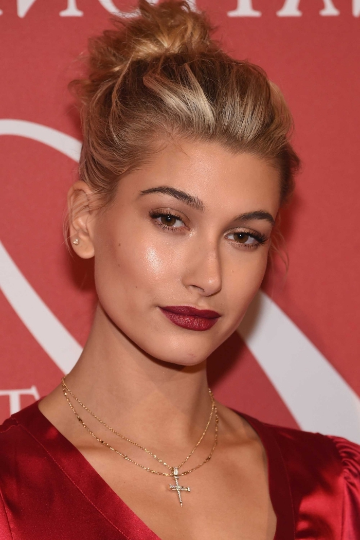natural looking makeup, worn by a blonde woman, with dark red lipstick, subtle nude beige eyeshadow