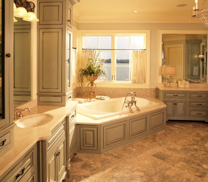 vintage-style bathroom, with creamy grey furniture, white elevated bathtub, brownish-grey floor, and a window with white blinds