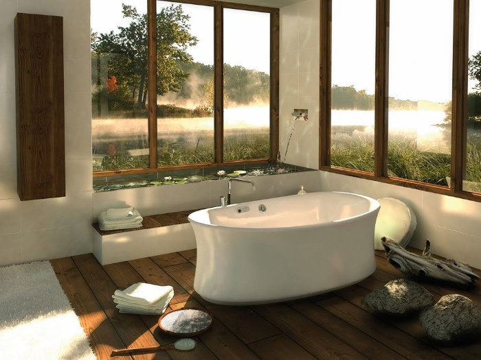 smooth white bathtub, inside a room with several large windows, brown wooden floor, and a pale rug, bathroom remodel pictures, natural pieces of wood used as decorations