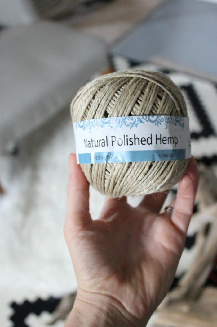 ball of beige rope, with a white and blue label, saying natural polished hemp, held by a hand, how to decorate your room, and make jewelry stands