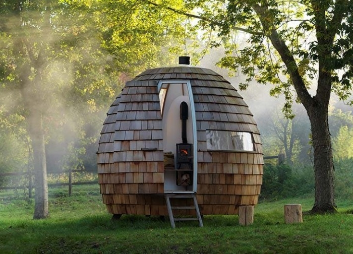 pod-like oval she shed, with a small window and a narrow door, opened to reveal a heater inside