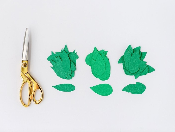 preparing the materials, diys for your room, three piles of leaf-shaped paper cutouts, in different shades of green, next to a pair of scissors