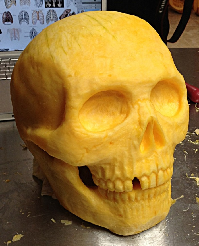anatomically correct human skull, with lots of details, and one tooth missing, carved from a pumpkin, skeleton pumpkin ideas