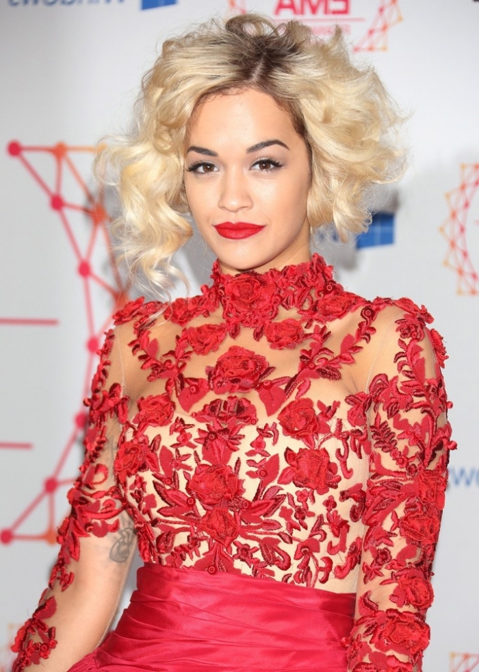 semi-see through red lace dress, with floral motifs, worn by rita ora, with platinum blonde hair, red lipstick and black mascara
