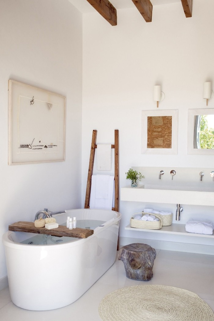 master bathroom ideas, white toom with an oval white bath, pale cream floor, and rustic wooden details