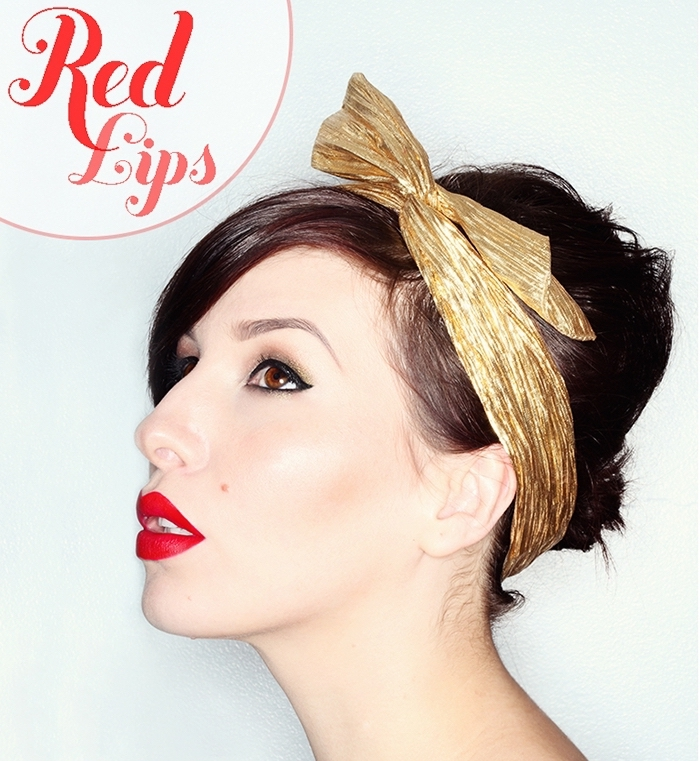 1950s-style headband in gold, worn by a brunette woman, with red lipstick, and black eyeliner, christmas eye makeup, festive party looks