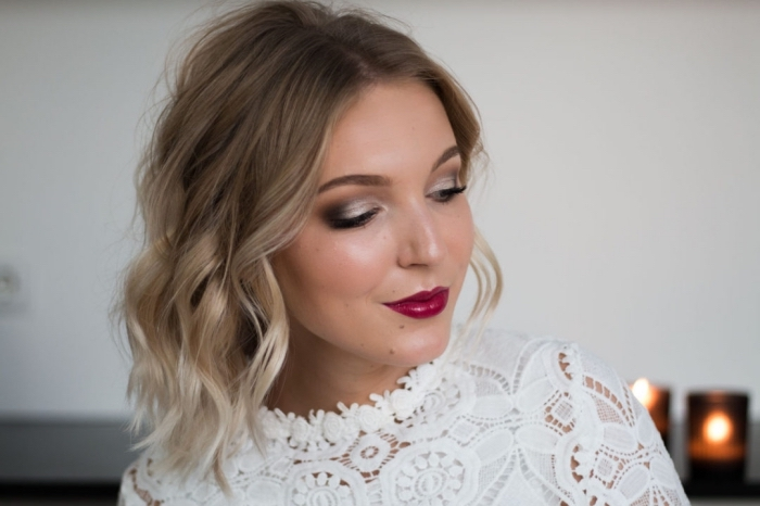 ombre shoulder length hair, worn by a smiling woman, burgundy lipstick and silver and grey smokey eye shadow, eye makeup for red lips, white lace top