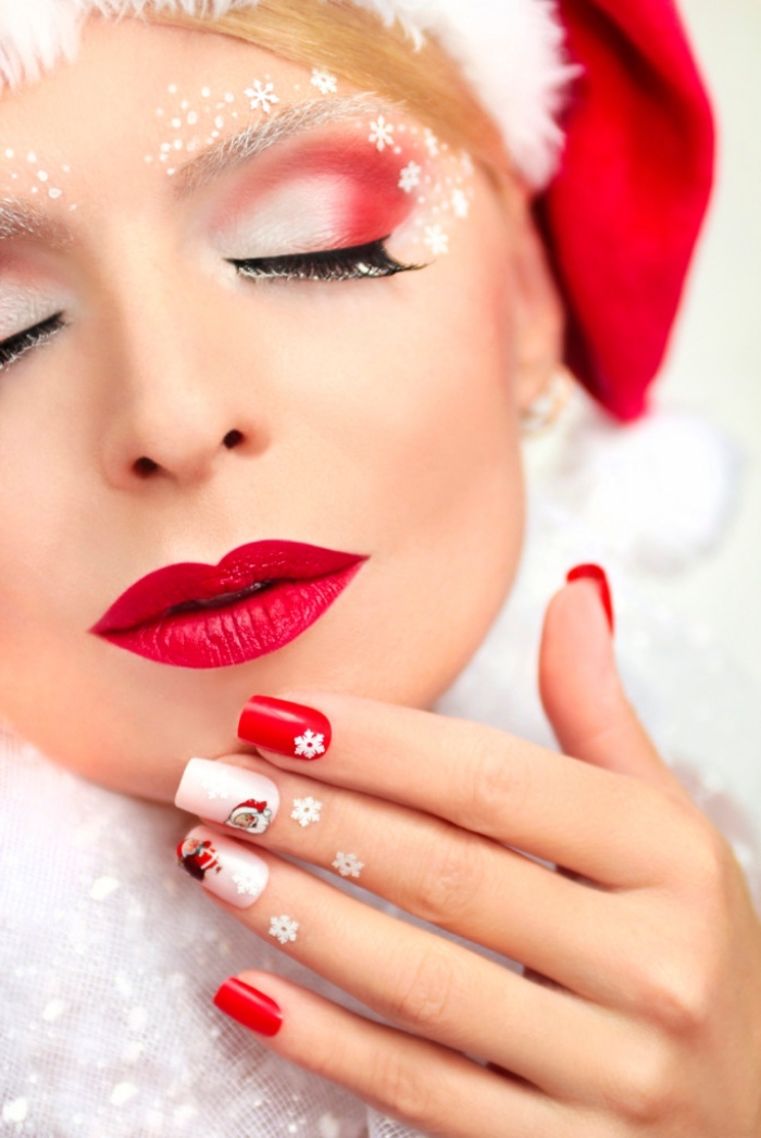 square long manicure, painted in red and white, and decorated with small stickers, worn by a pale woman, with red lipstick, and white and red eye shadow, christmas makeup looks, with snowflake stickers