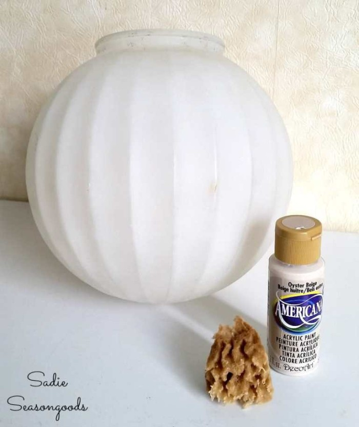 diy halloween witch decorations, halloween moon lamp, made from a sperical white lamp, painted in beige, with a sponge
