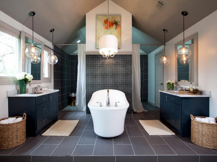 navy blue cupboards, inside a symmetrical room, with grey tiles on the floor, bath remodel ideas, white vintage-style bath, in the middle of the room