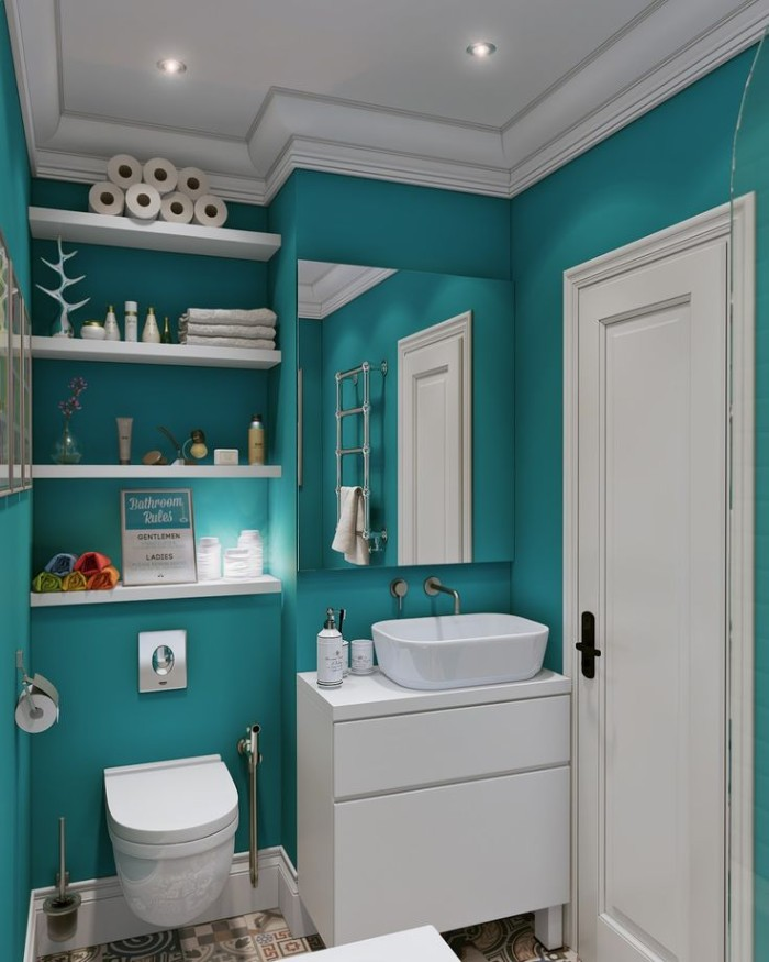 shelves with various toiletries, in a teal bathroom, containing a modern toilet, a white cupboard with a sink, and a mirror, small bathroom paint colors, white ceiling with inbuilt lights