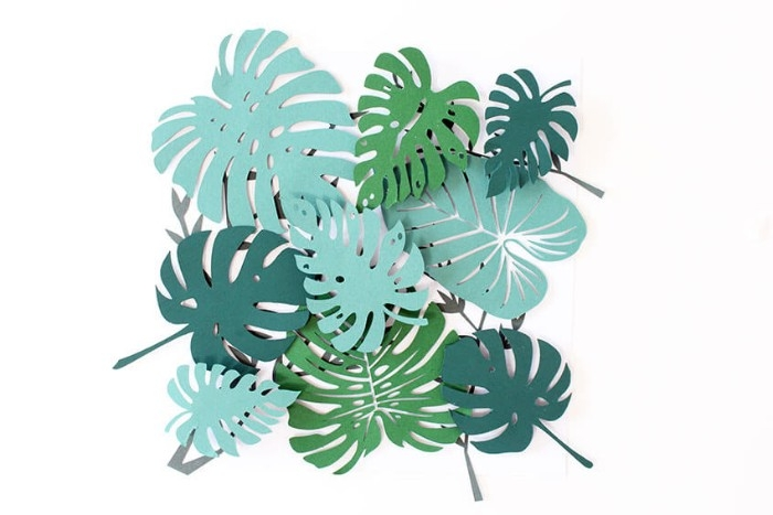 ready 3D paper collage, featuring different kinds of palm leaves, diy bedroom décor, on top of a square, white piece of paper