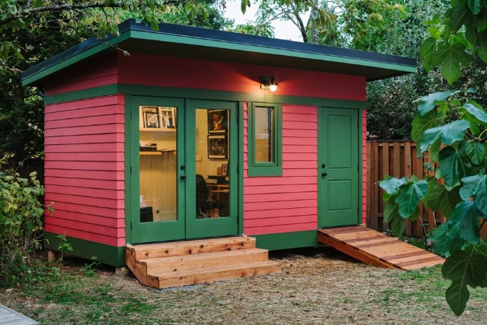 pink and green shed, resembling a watermelon, garden shed ideas, two doors with small stairs and a ramp