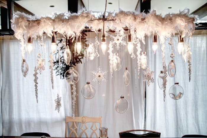christmas dining room decoration, white feathers and crystal ornaments, suspended from the ceiling, near seven lighbulbs